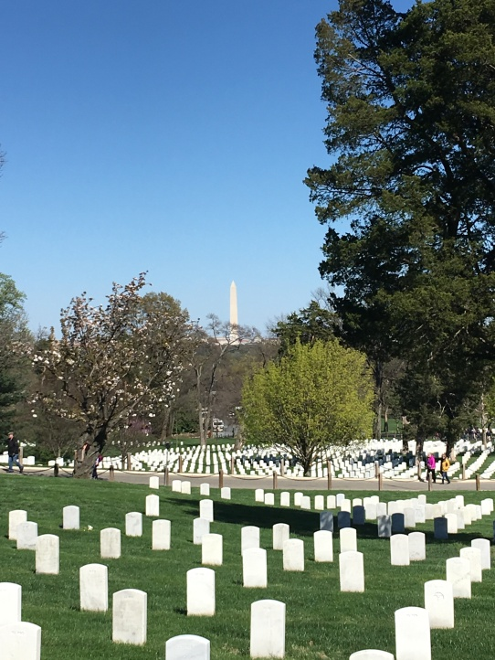 Arlington National Cemetery with the Washington Monument in the background